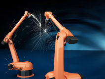 Industrial Robotic Arms. Modern Industrial Robotic Arms at assembling process Royalty Free Stock Images