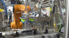 Industrial robotic flexible arm from company KUKA in action during the big exhibition PacTec in Helsinki stock video