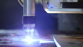 Industrial robotic laser cutter cuts metal parts with great precision just like a knife through butter stock video