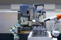 Free Industrial Robotic Working With Metal Part And CNC Machine On Smart Factory Royalty Free Stock Image - 215488716