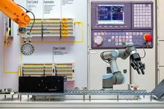Industrial robotics automation working via conveyor belt on smart factory,. Terminal and control panel background, industry 4.0 concept stock photo