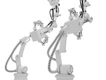 Industrial robots. Industrial autonomous robots are operating in a factory Royalty Free Stock Photos