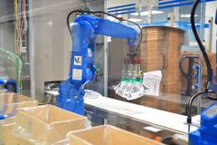 Industrial robots in a modern pharamceutical factory - transport Royalty Free Stock Photography