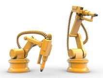 Industrial robots. Are operating in a factory Royalty Free Stock Images