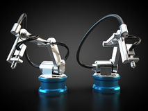 Industrial robots. Two robots on black background are operating Stock Images