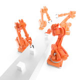 Industrial robots. Working on a production line Royalty Free Stock Photography