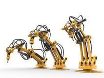 Industrial robots. Yellow industrial robots are operating hydraulically Royalty Free Stock Photos