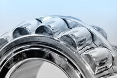 Industrial roller bearing blue toning. Industrial roller bearing on a light background. Blue toning. Shallow depth of field, selective focus Stock Photography