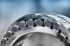 Industrial roller bearing. Blue toning. Shallow depth of field, selective focus royalty free stock photos
