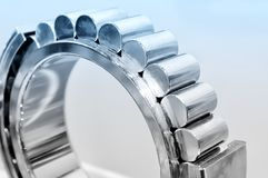 Industrial roller bearing blue toning. Industrial roller bearing on a light background. Blue toning. Shallow depth of field, selective focus stock image