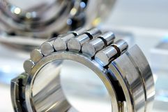 Industrial roller bearing on a light background. Shallow depth of field, selective focus Royalty Free Stock Photos
