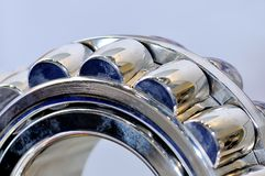Industrial roller bearing on a light background. Shallow depth of field, selective focus Royalty Free Stock Photography