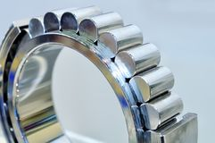Industrial roller bearing on a light background. Shallow depth of field, selective focus Stock Image