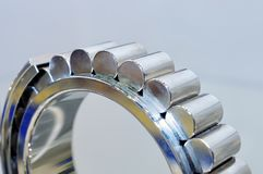 Industrial roller bearing on a light background. Shallow depth of field, selective focus Stock Photo