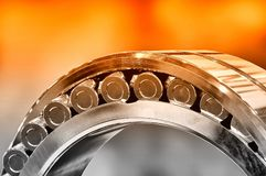 Industrial roller bearing. Red toning. Shallow depth of field, selective focus Stock Images