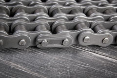 Industrial roller chain. Industrial driving  roller chain on dark background Stock Photos
