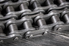 Industrial roller chain. Industrial driving  roller chain on dark background Stock Images