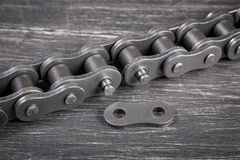 Industrial roller chain. Industrial driving  roller chain on dark background Royalty Free Stock Image