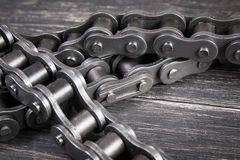 Industrial roller chain. Industrial driving  roller chain on dark background Stock Photo