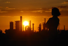 Industrial romantic - oil refinery sunset Royalty Free Stock Image