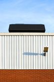 Industrial roof. Industrial facade with roof cooling unit Stock Photos