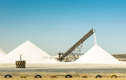 Industrial salt refinery with operating conveyor belt Royalty Free Stock Photo