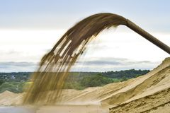 Industrial sand mining pumping out the pumping station. Background. royalty free stock photo