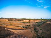 Industrial sand quarry with hydraulic excavator machinery for construction. industrial landscape, construction industry. Industrial sand quarry with hydraulic royalty free stock image