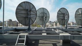 Industrial satellite dishes on the roof of a building.  stock video