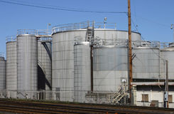 Industrial scene. Large tanks in an industrial area Stock Images