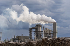 Industrial scene. With chimneys and stormy sky Stock Photos