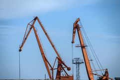 Industrial scene on sky background. Industrial scene with crane and river port facilities on blue sky background royalty free stock photography