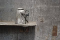 Industrial scene: old teapot in a steel mill. Teapot of a workingman in an abandoned steel mill, industrial still life Royalty Free Stock Photo