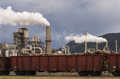 Industrial scene. With train and stormy sky Royalty Free Stock Images