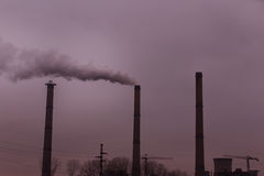Industrial scenery with smoke from coal power plant Stock Photos