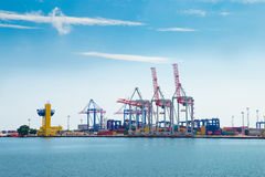 Industrial sea port with colorful containers cand crans Royalty Free Stock Images