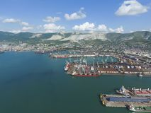 Industrial seaport, top view. Port cranes and cargo ships and ba Royalty Free Stock Image