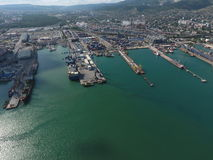Industrial seaport, top view. Port cranes and cargo ships and barges. Stock Image