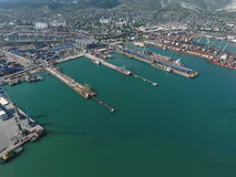 Industrial seaport, top view. Port cranes and cargo ships and barges. Stock Photo