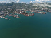 Industrial seaport, top view. Port cranes and cargo ships and barges. Stock Images