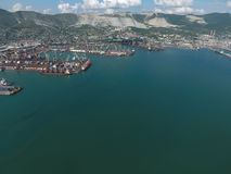 Industrial seaport, top view. Port cranes and cargo ships and barges. Royalty Free Stock Photo