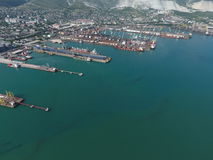 Industrial seaport, top view. Port cranes and cargo ships and barges. Royalty Free Stock Photos