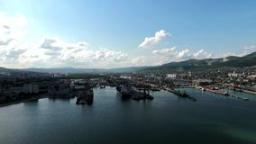 Industrial seaport, top view. Port cranes and cargo ships and barges. stock video