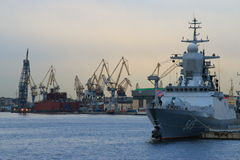 Industrial seascape with warship Stock Image