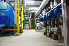 Industrial sector. Inside industrial plant - pipes and drums, device Royalty Free Stock Photos