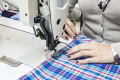 Industrial sewing machines with sewing machine operator Stock Photo