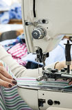 Industrial sewing machines with sewing machine operator Royalty Free Stock Photos
