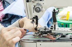 Industrial sewing machines with sewing machine operator Royalty Free Stock Images