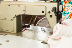 Industrial sewing machines. With workers being sewn Stock Photography