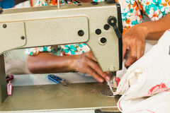 Industrial sewing machines. With workers being sewn Royalty Free Stock Photos